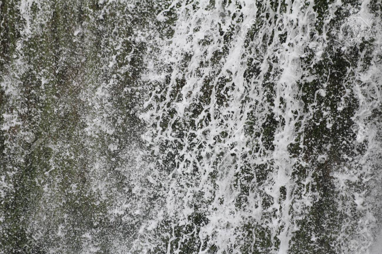 Stream of water, in a waterfall Stock Photo - 12869085