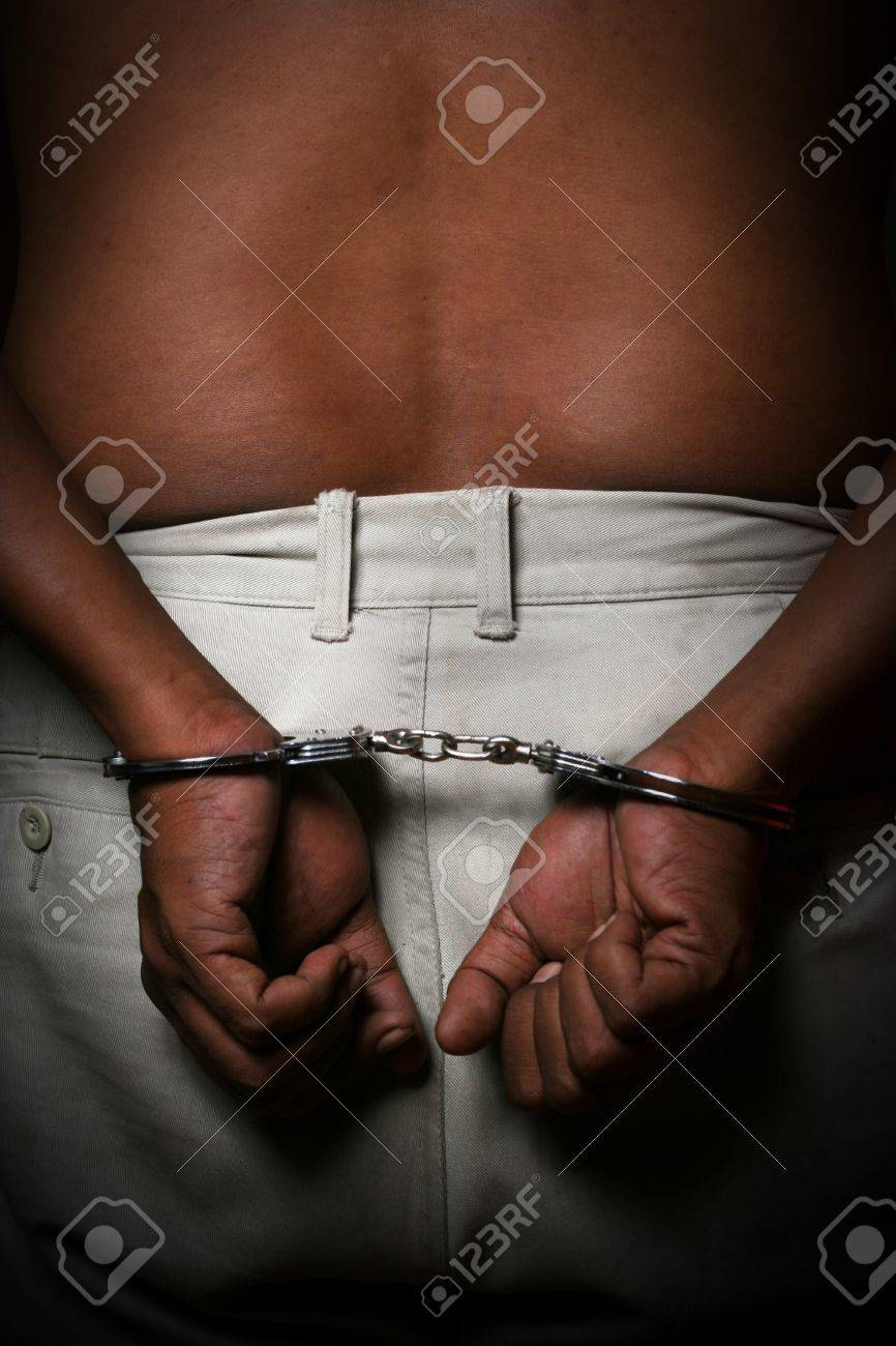 Man in handcuffs on black background Stock Photo - 18464253