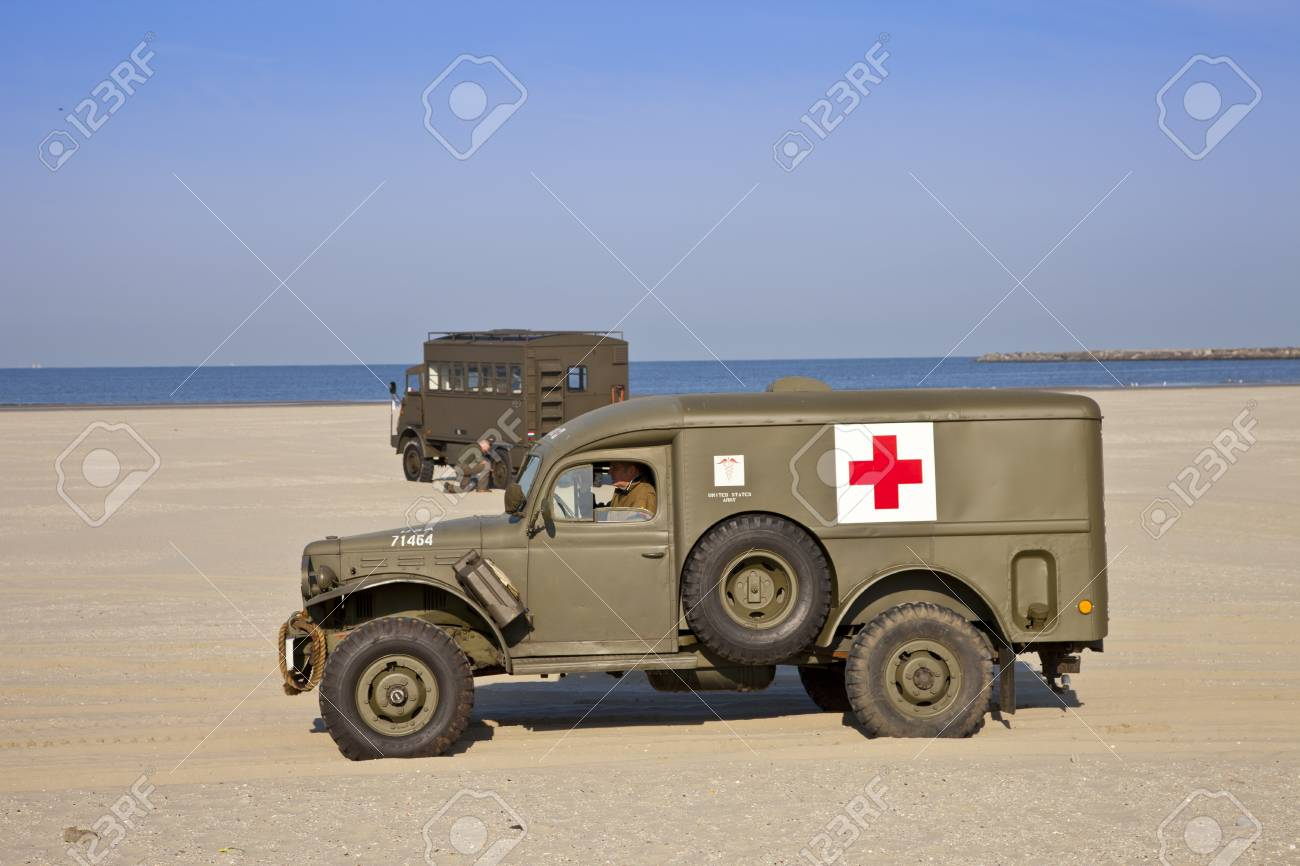 IJMUIDEN, THE NETHERLANDS-MAY 5: Kelly's Heroes medical army vehicle riding on beach on May 5,2011 in IJmuiden, The Netherlands. Kelly's Heroes celebrates the liberation of The Netherlands in 1945 Stock Photo - 9541784