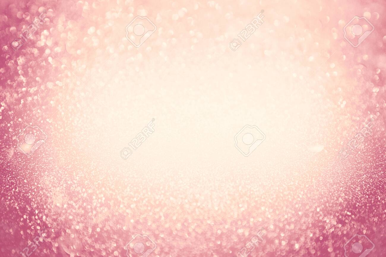 Abstract bokeh background. Christmas Glittering background. Abstract christmas coral color background. Glittering Christmas background. Pink christmas background Glitter christmas background. - 134459181