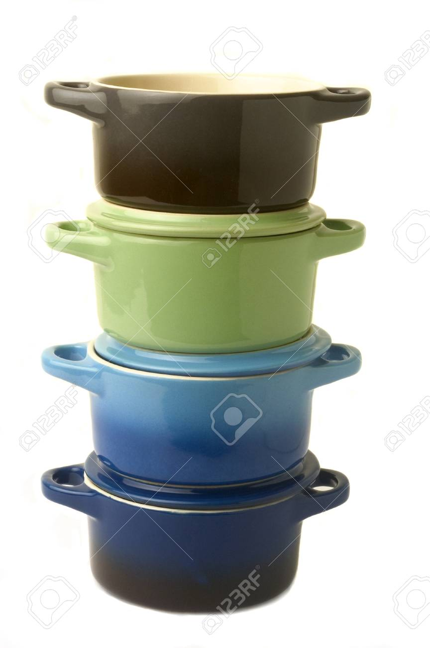 Mini casseroles individual which makes it possible individually to simmer a dish while adding an original character to the presentation. Stock Photo - 16292879