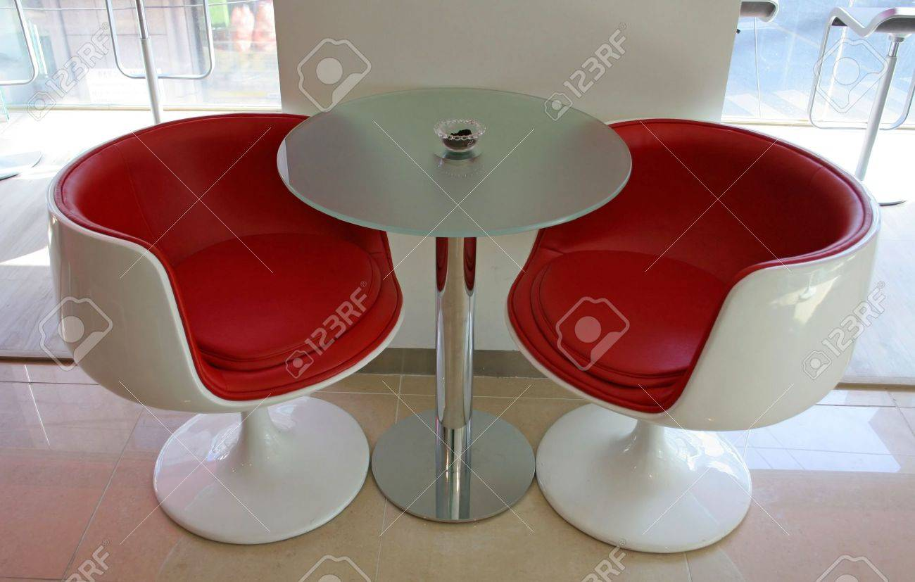 Two modern red chairs and a table Stock Photo - 302458
