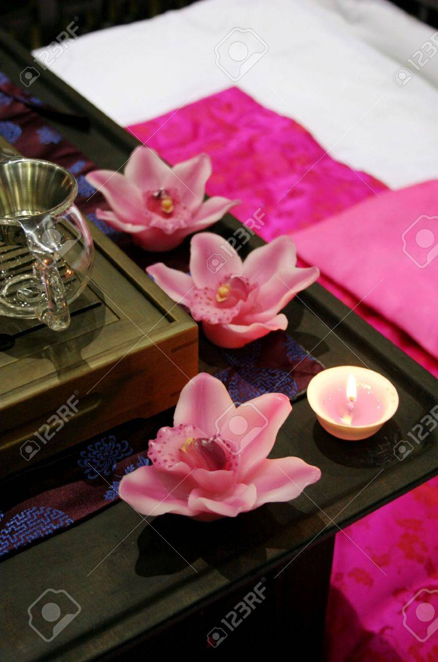 Beautiful pink spa with flower candles Stock Photo - 356679
