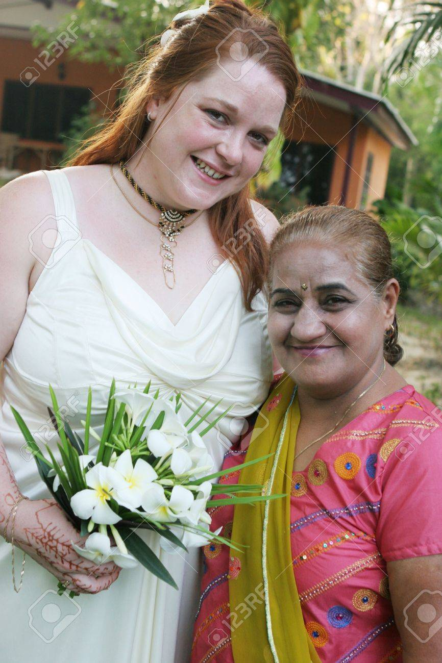 Red headed woman with an Indian woman Stock Photo - 712411