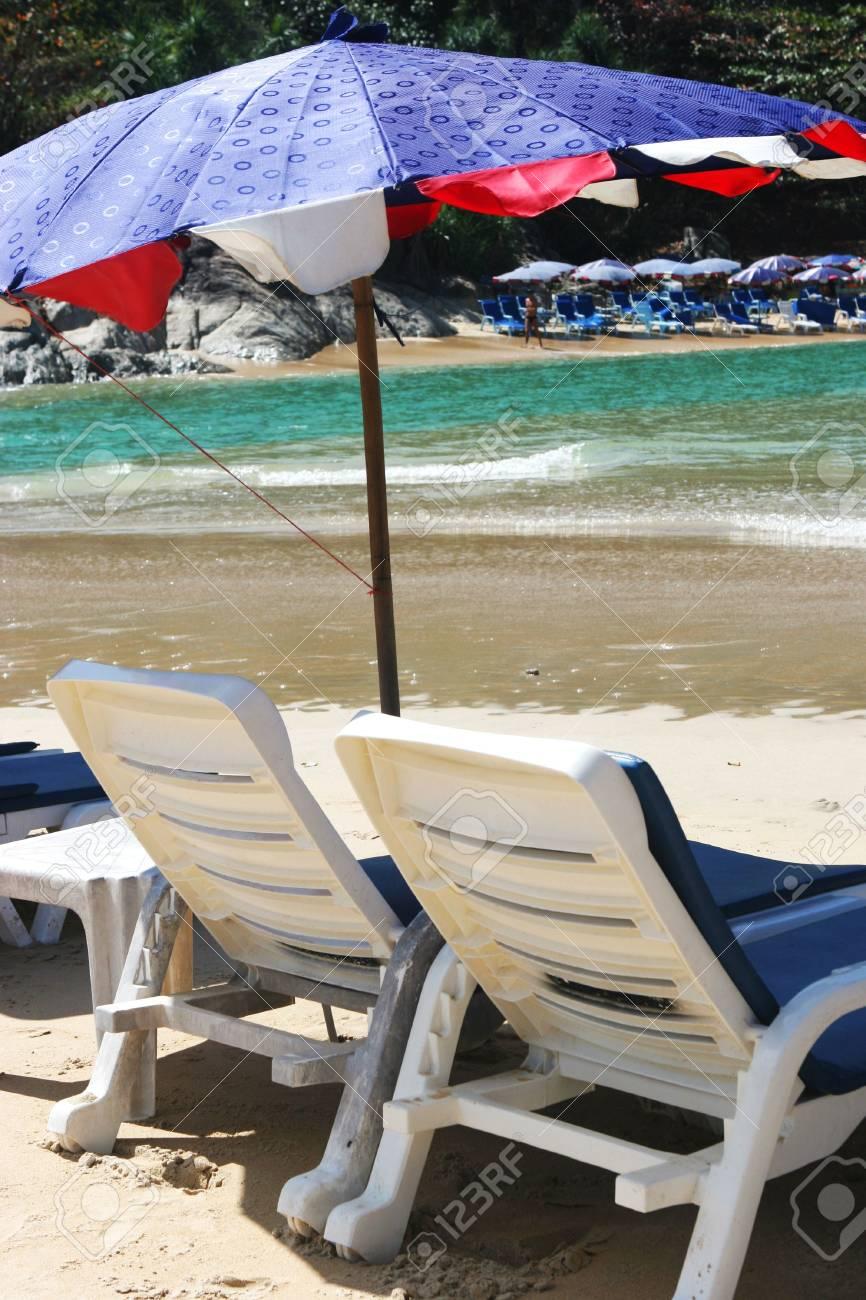 Colorful beach umbrellas overlooking the sea. Stock Photo - 2735671