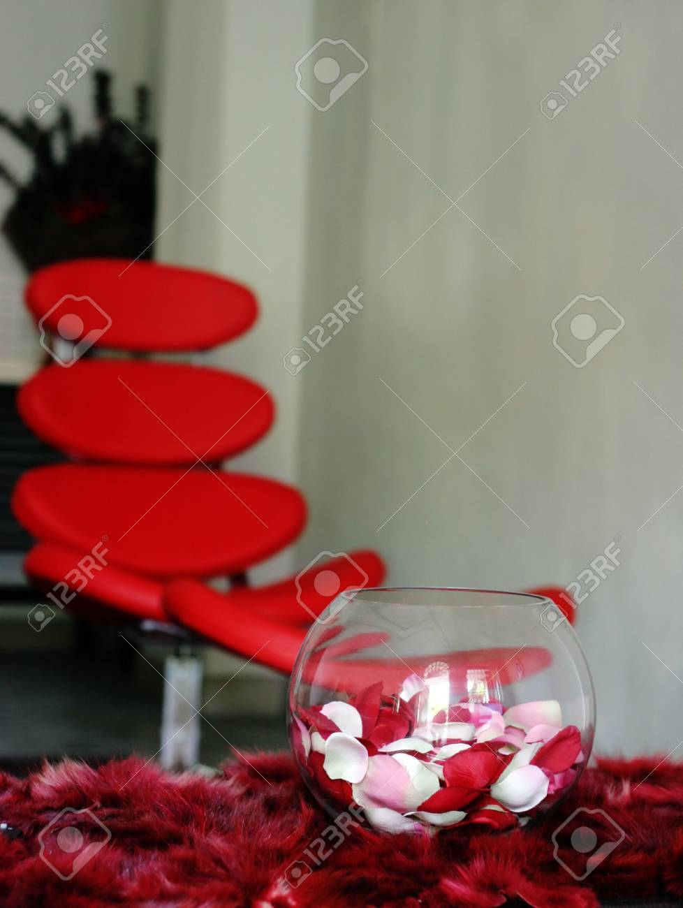 Vase of Roses on Table Vase of Rose Petals on a Table