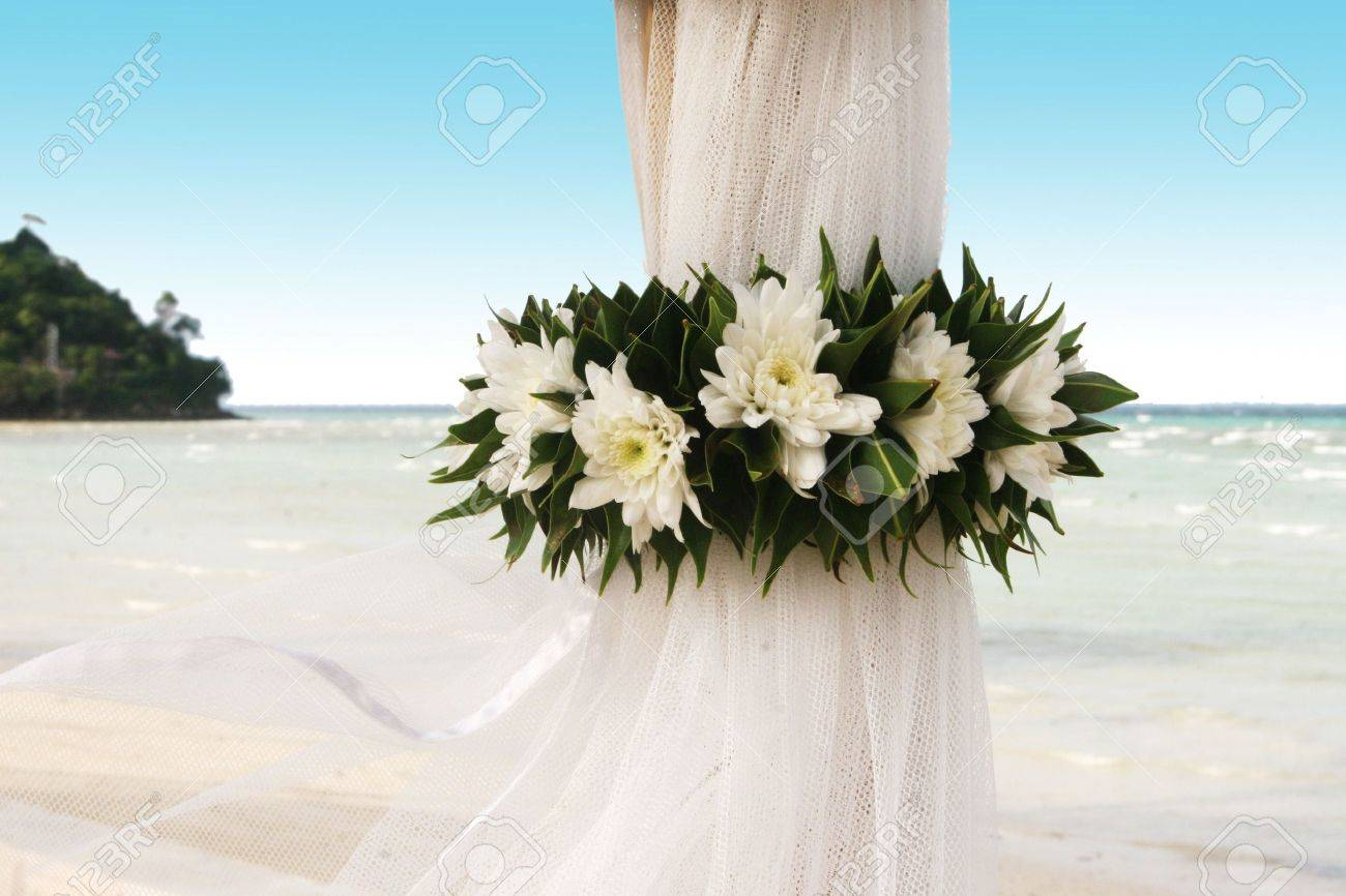 Floral arrangement at a wedding ceremony on the beach. Stock Photo - 4028280