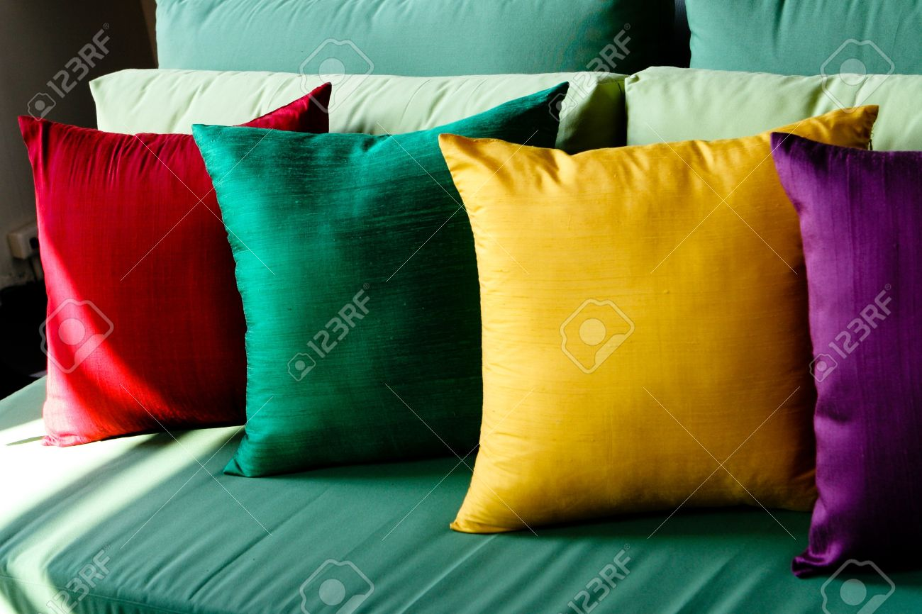 colorful silk pillows on a sofa home interiors stock photo s