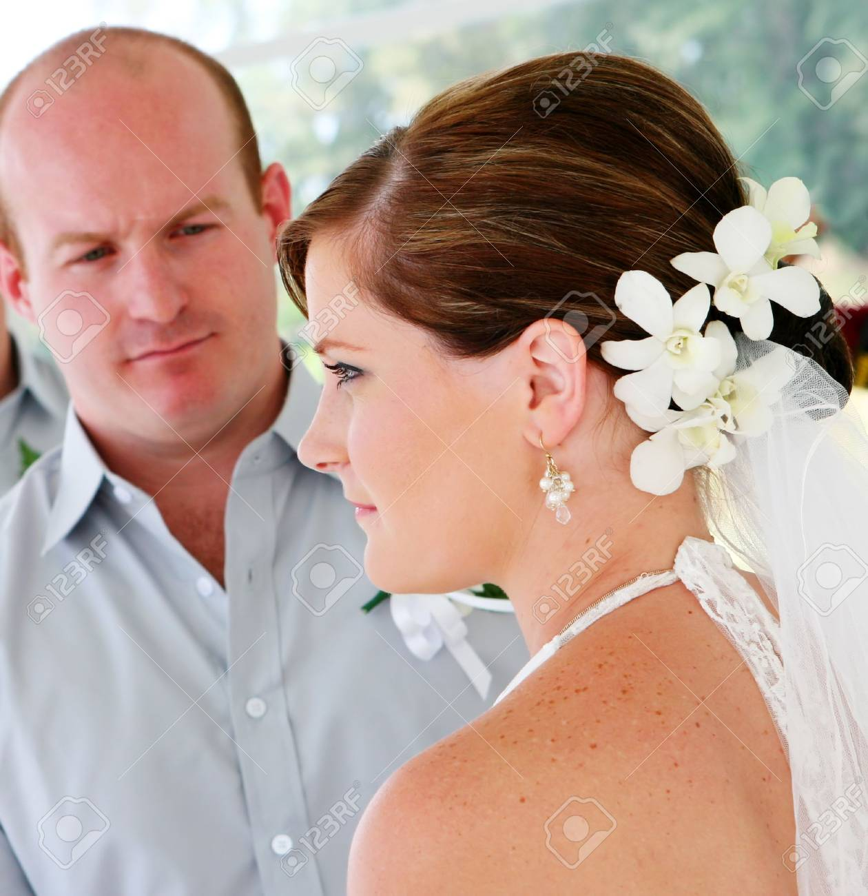 Bride and groom during their wedding day ceremony. Stock Photo - 4445832