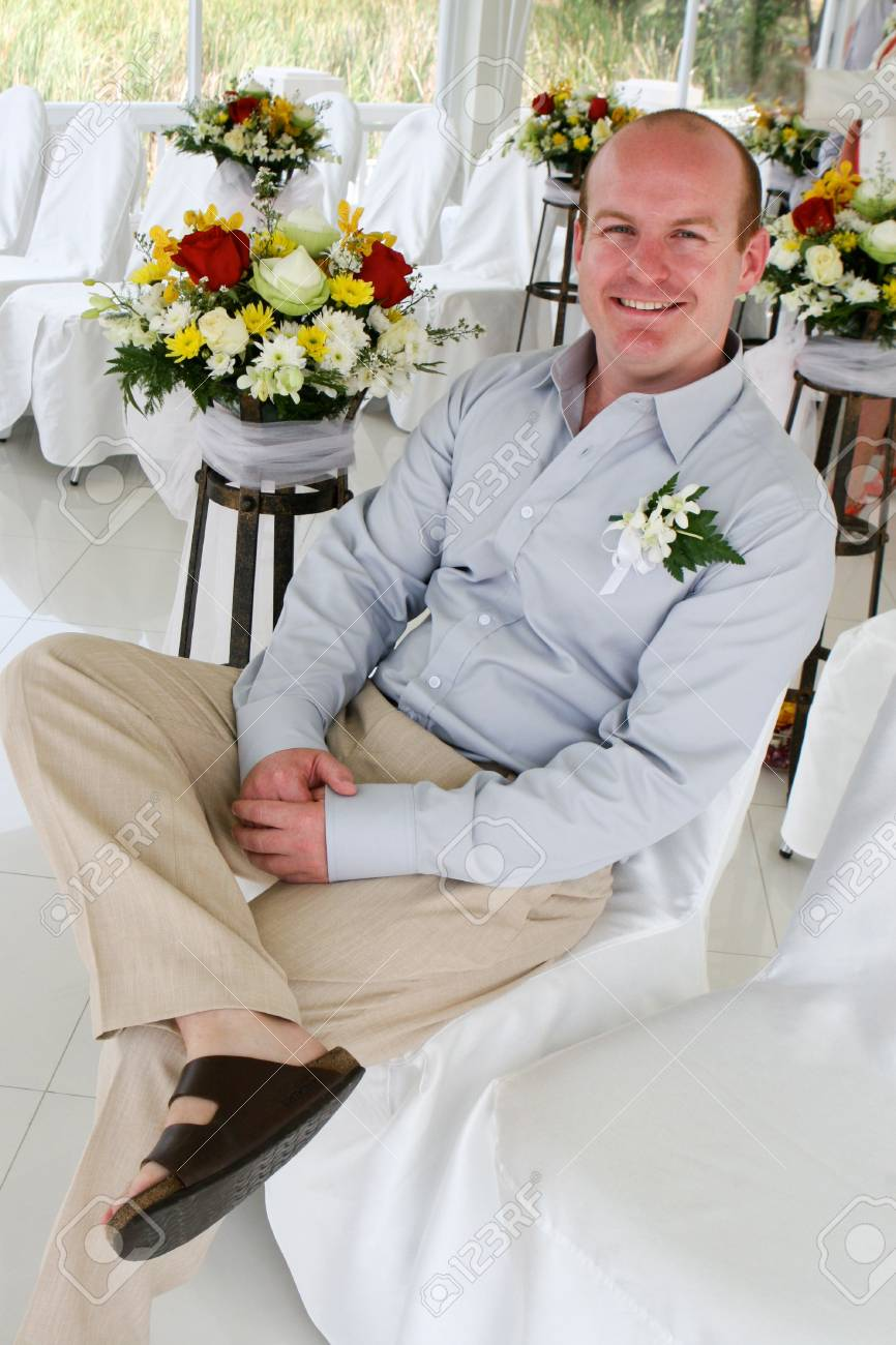 Happy groom in church on his wedding day. Stock Photo - 4445857