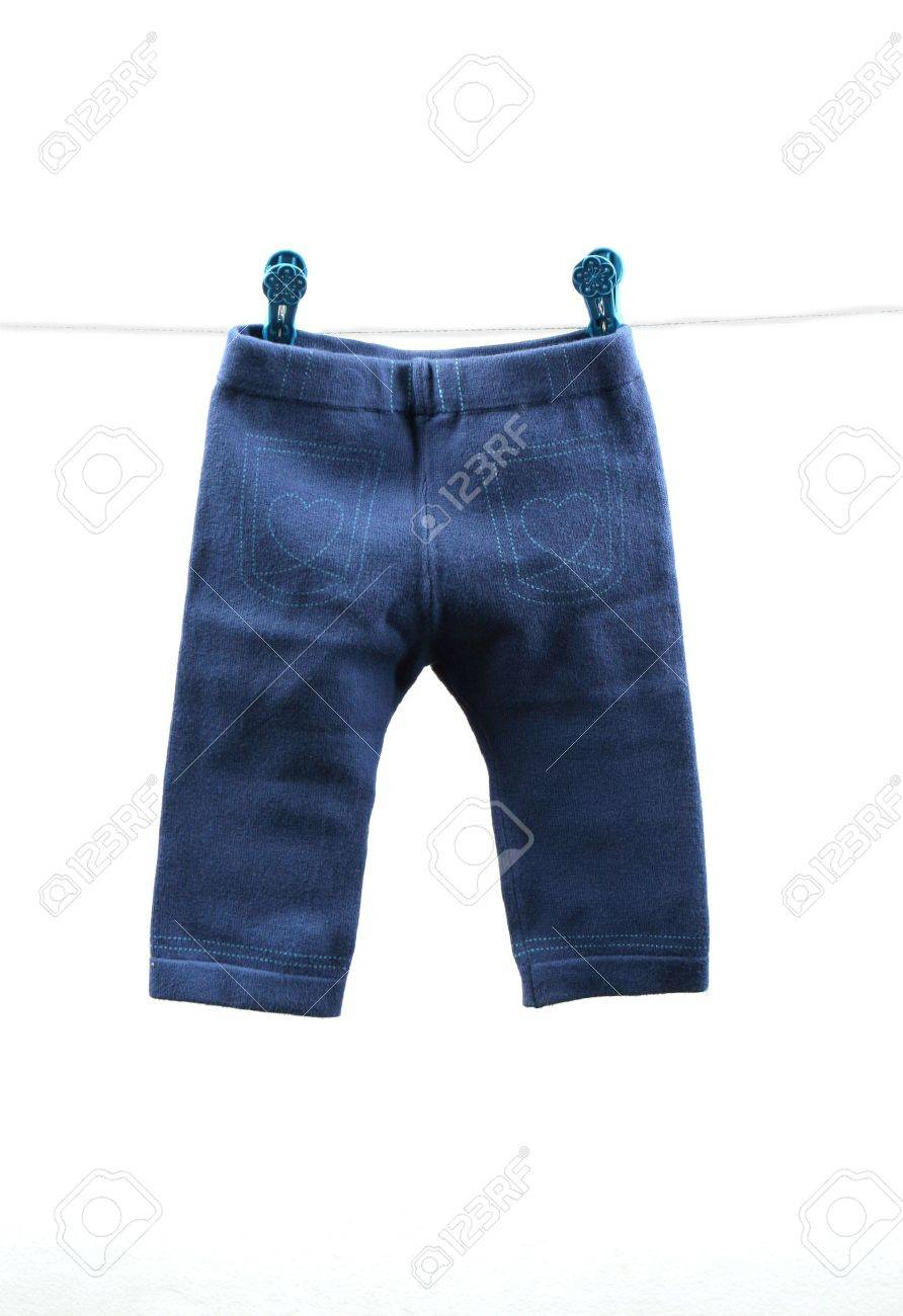 Pair of blue baby's pants hanging on a clothes line - isolated. Stock Photo - 4658543