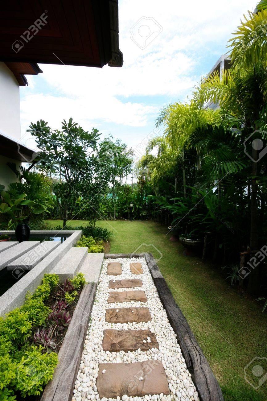 Modern house and garden - Exterior Of A Modern House And Garden Stock Photo 4706835