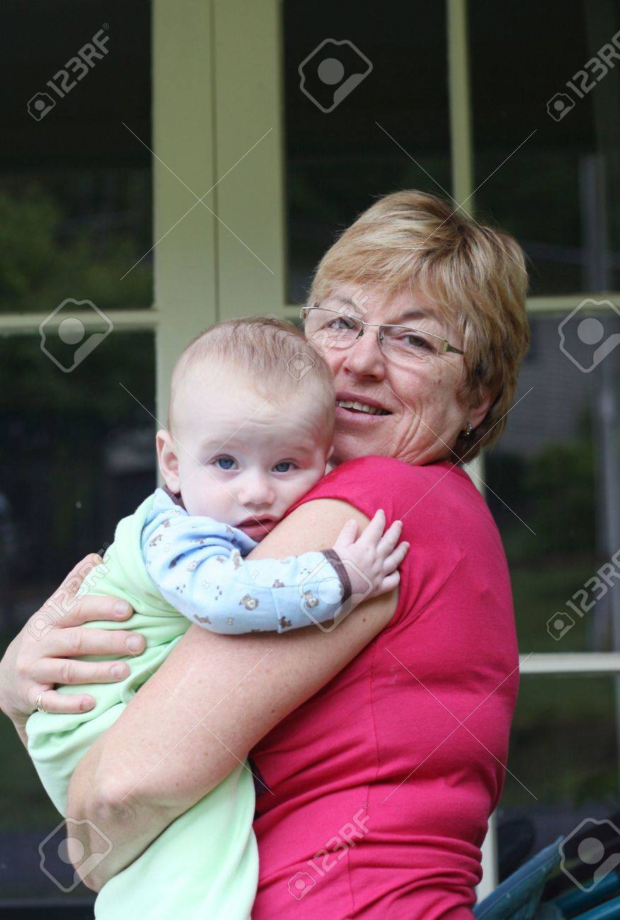 Young baby being held by his grandmother. Stock Photo - 6161108
