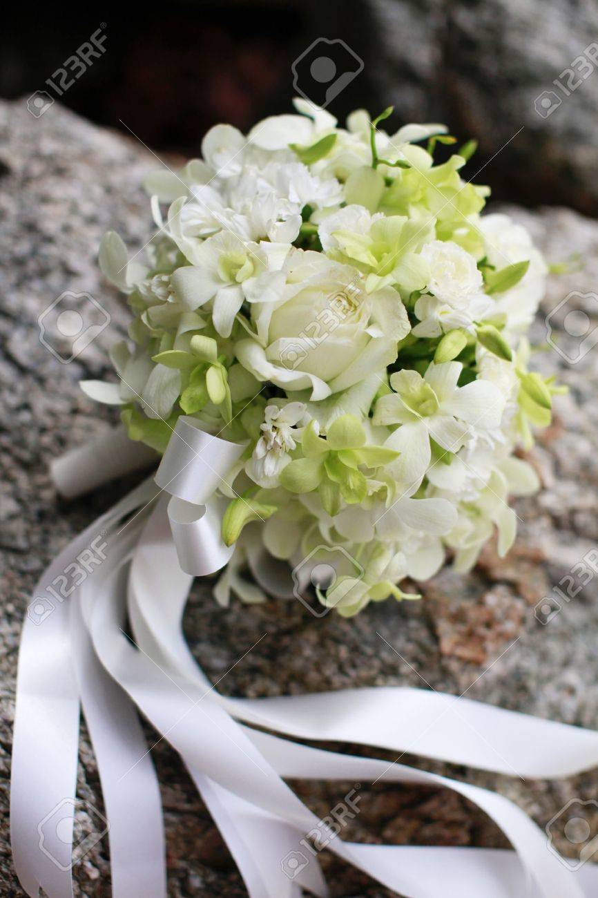 Beautiful Wedding Bouquet Of White Orchids And Roses Stock Photo
