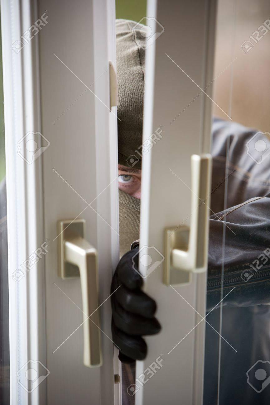 Burglar breaks into a residential building. Stock Photo - 2726273