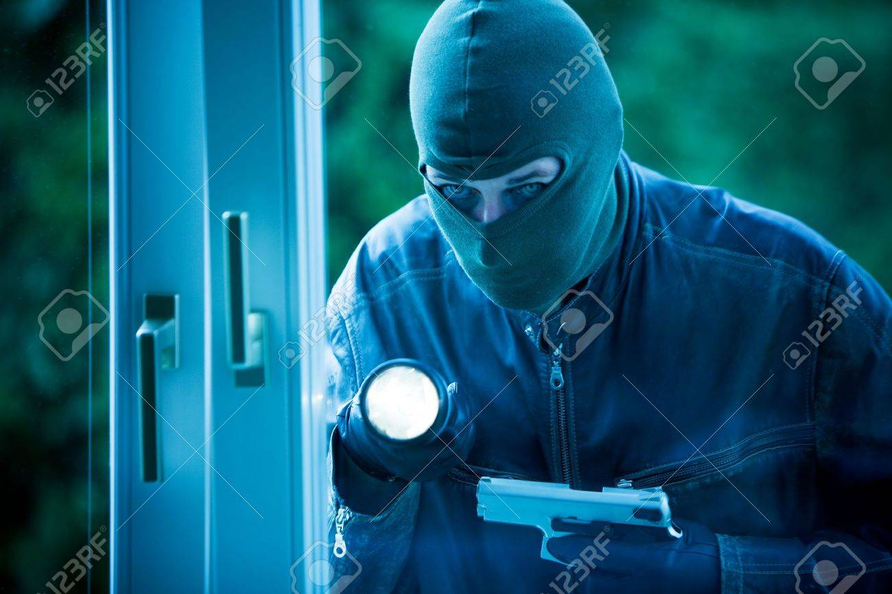 Burglar breaks into a residential building. Stock Photo - 2726287