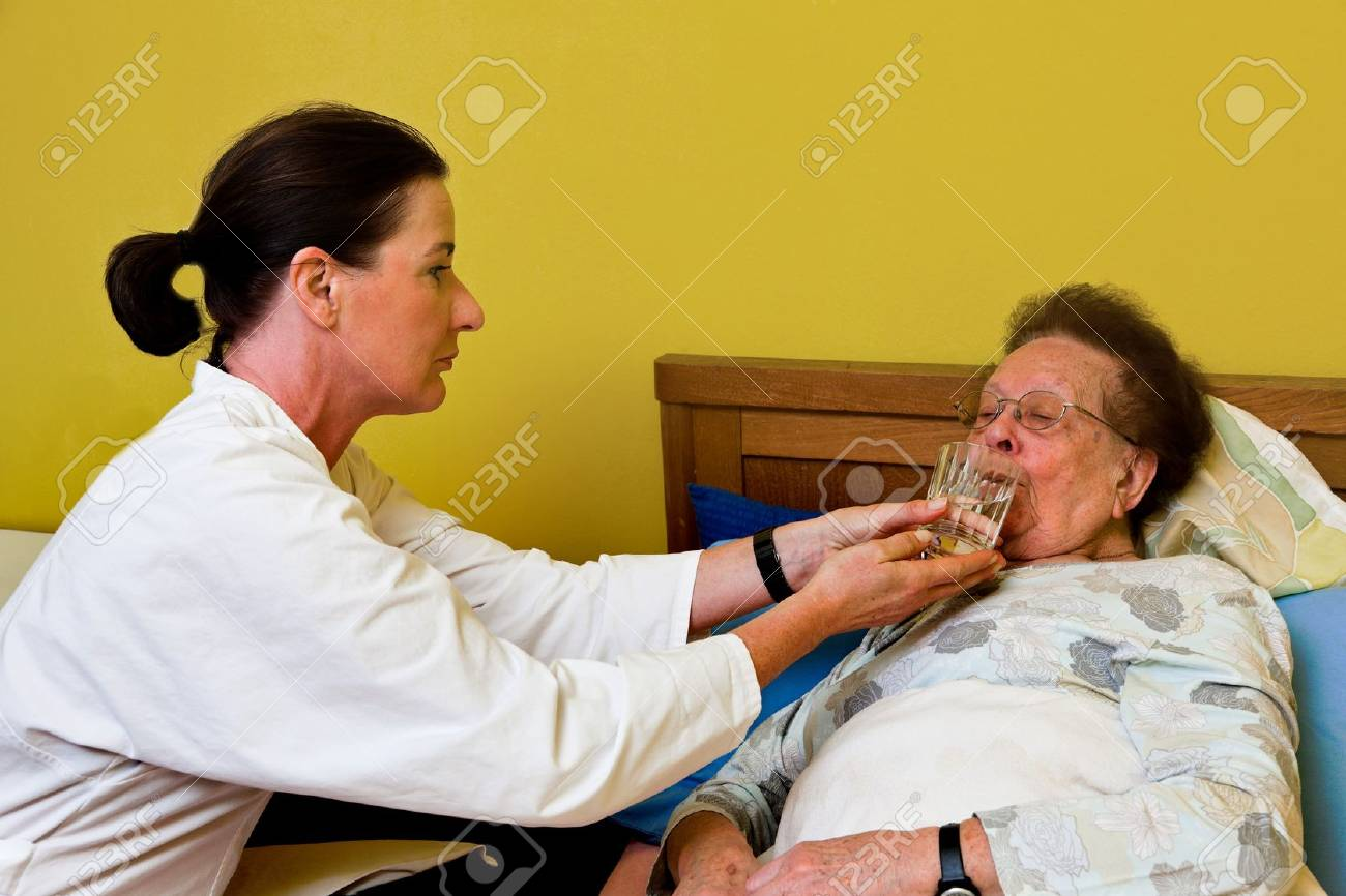 Sick senior is visited by daughter Stock Photo - 4318890
