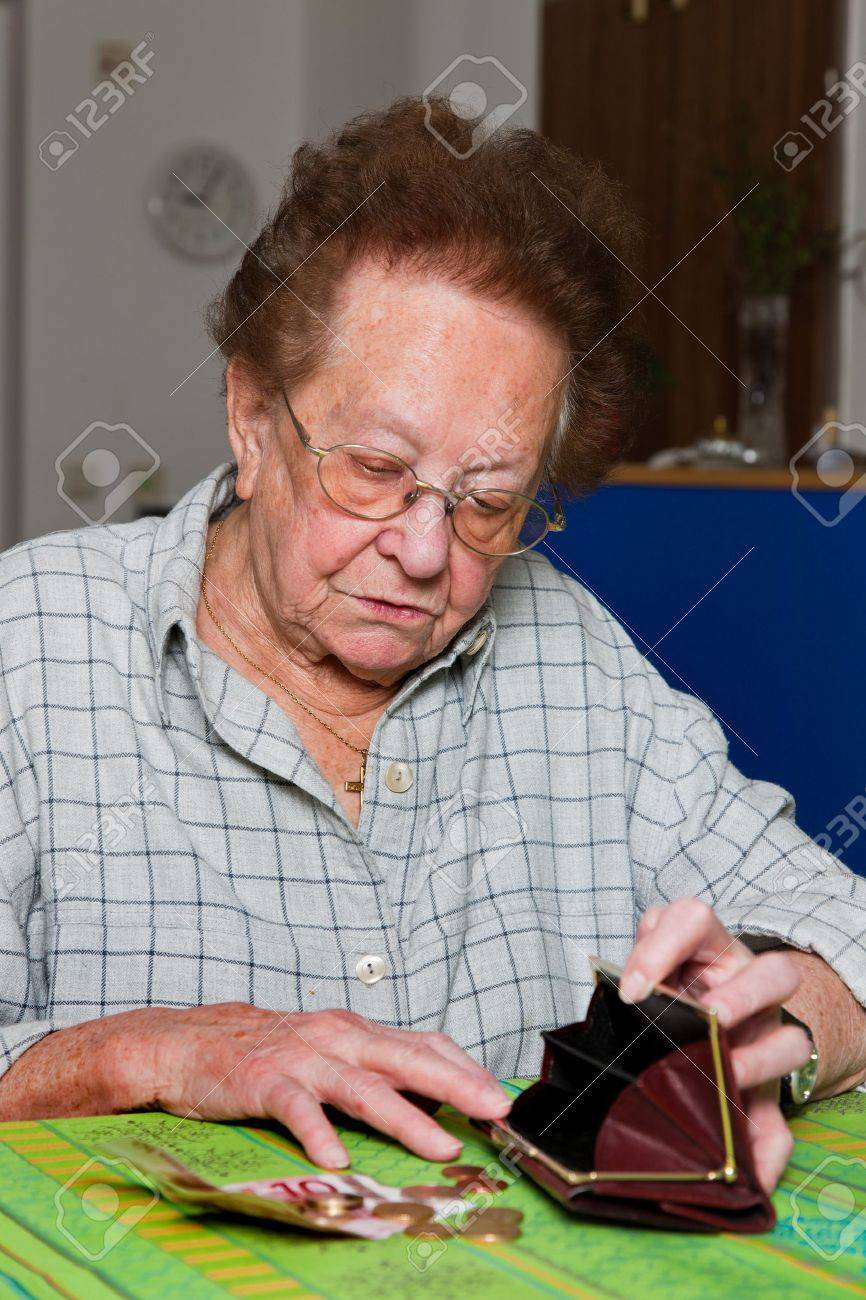 Old woman counts her money Stock Photo - 4318914