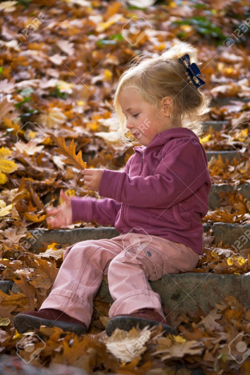 Child with leaves of a tree in autumn Stock Photo - 4357255
