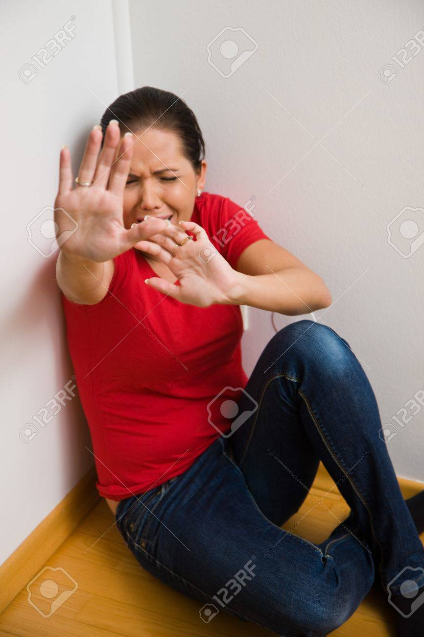 Timid woman symbol of violence in the family stock photo picture timid woman symbol of violence in the family stock photo 4413008 buycottarizona Choice Image