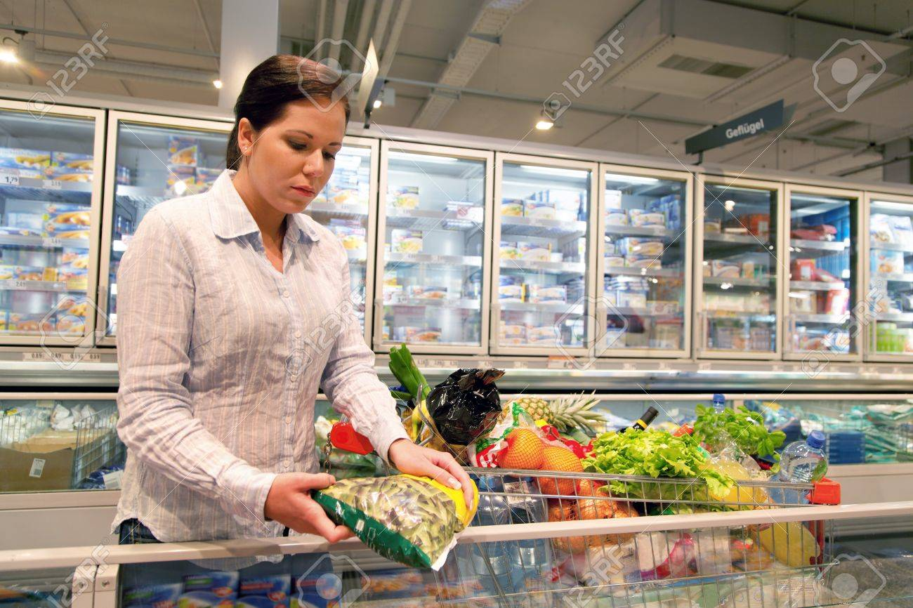 Young woman in the supermarket to buy food and fruit one. Stock Photo - 4413065