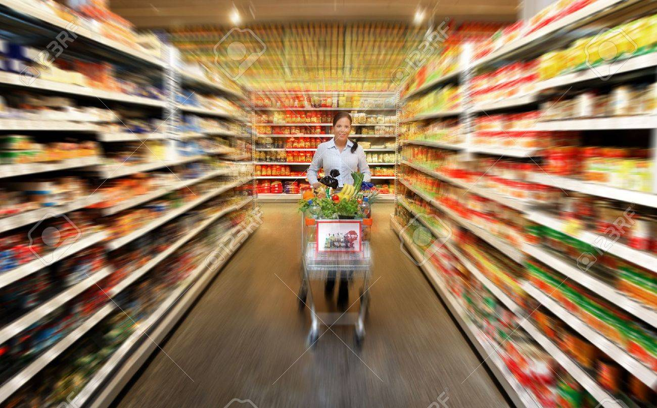 Woman in a supermarket to buy fresh food Stock Photo - 4413038
