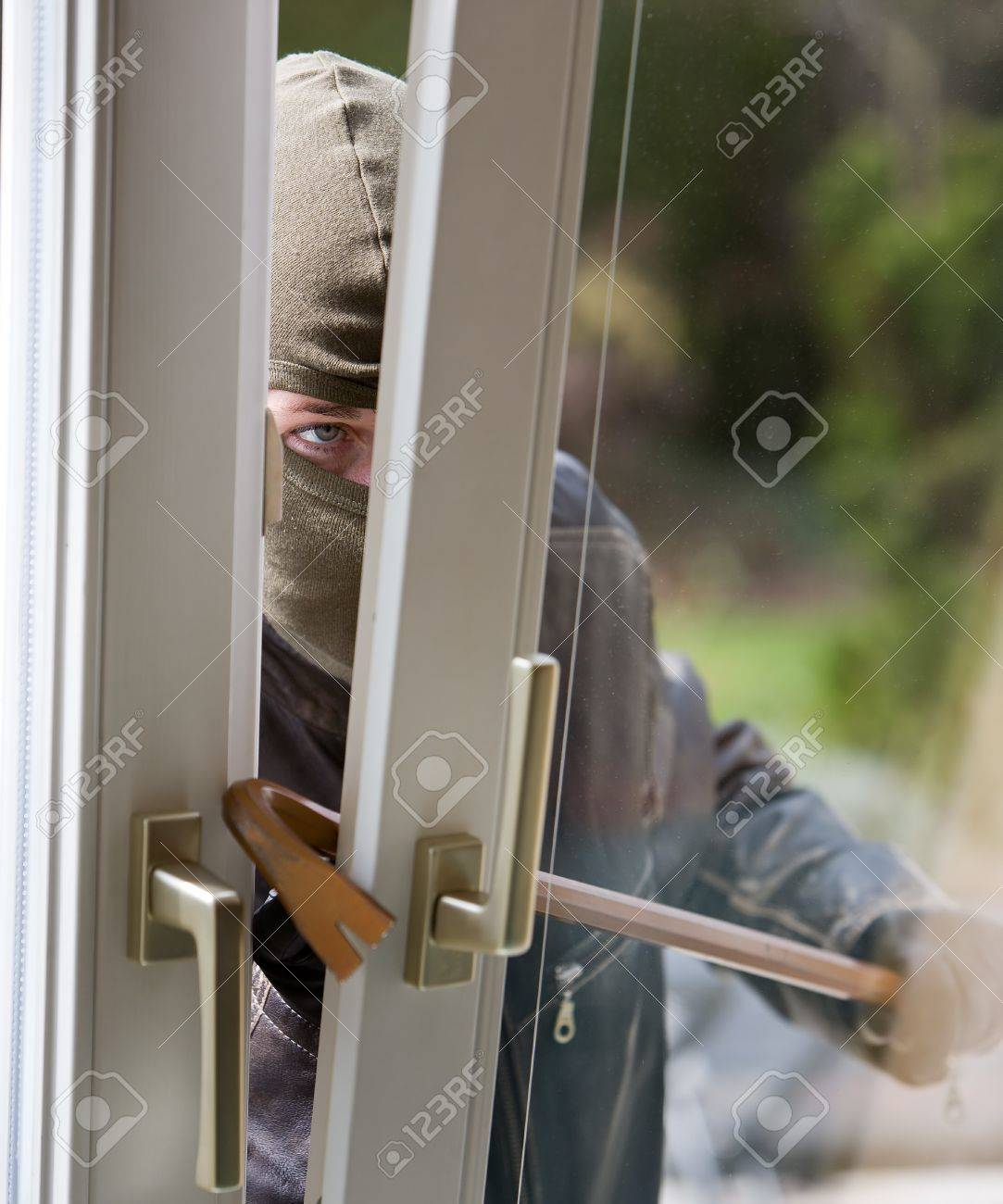 A burglar at a window of a house. Stock Photo - 7993673