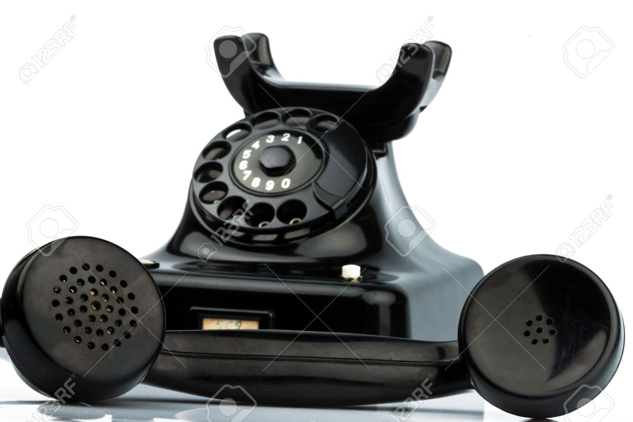 An old, old landline telephone. Phone on a white background. Stock Photo - 8114840