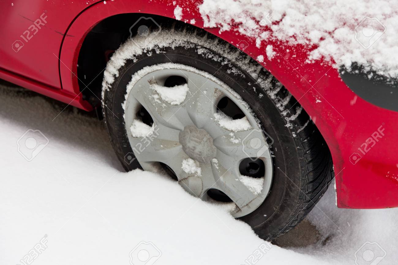 Winter tires of a car in the snow. Driving in the winter. Stock Photo - 8705609