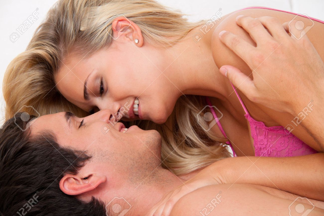 Couple in bed with sex and affection. Love and eroticism in the bedroom. Stock Photo - 8705705