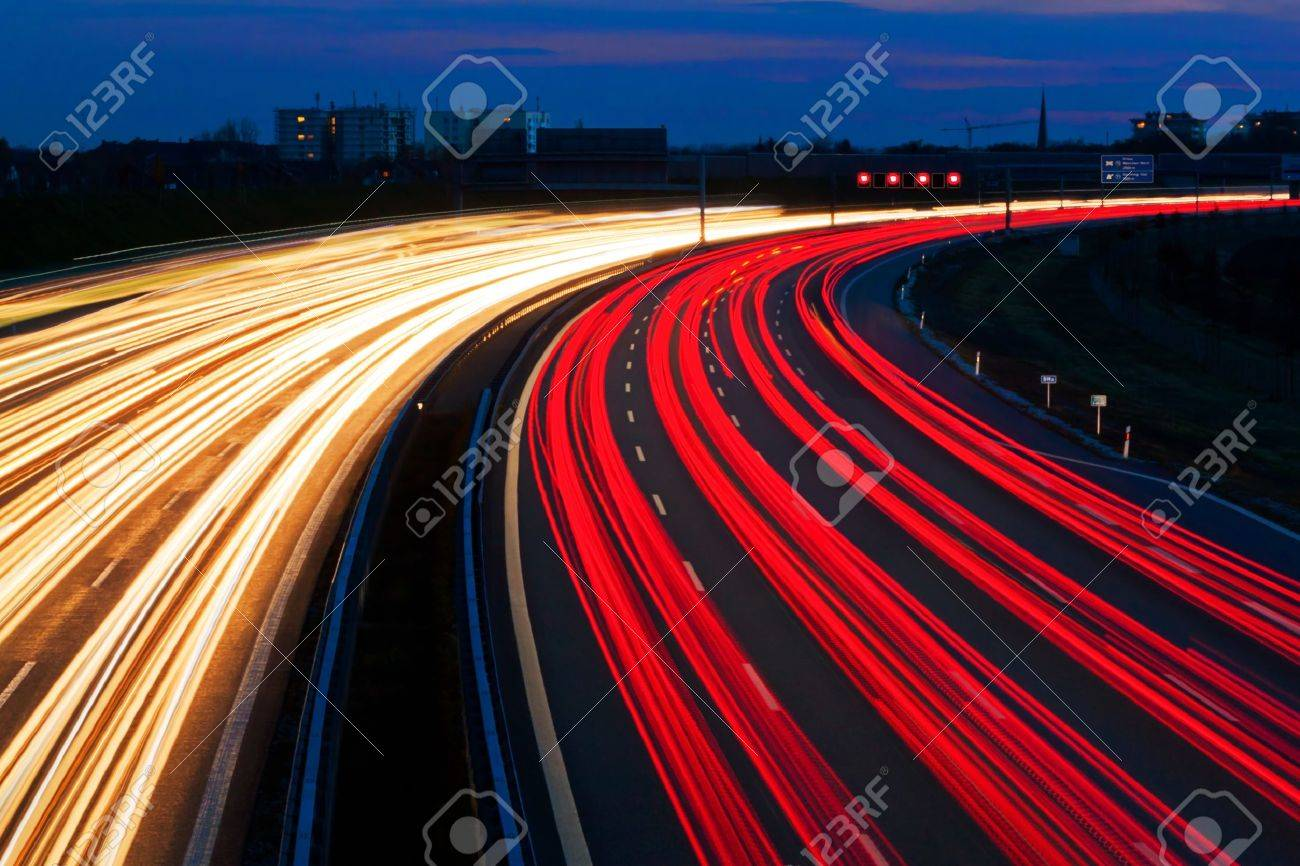 Cars at night on a highway rope lights and illuminated signs stock rope lights and illuminated signs stock photo 9009059 aloadofball Image collections
