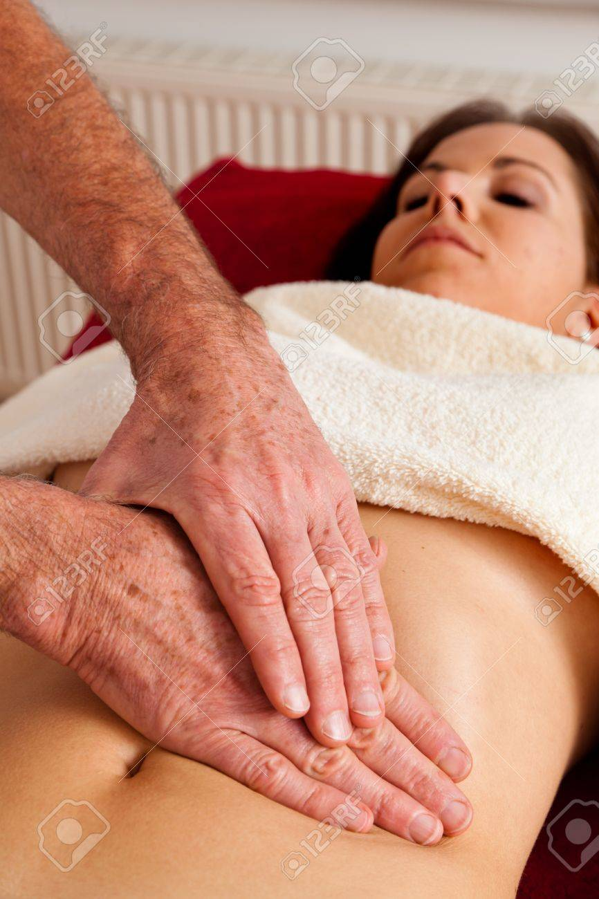 Relaxation, peace and well-being through massage. Abdomen Stock Photo - 9199381