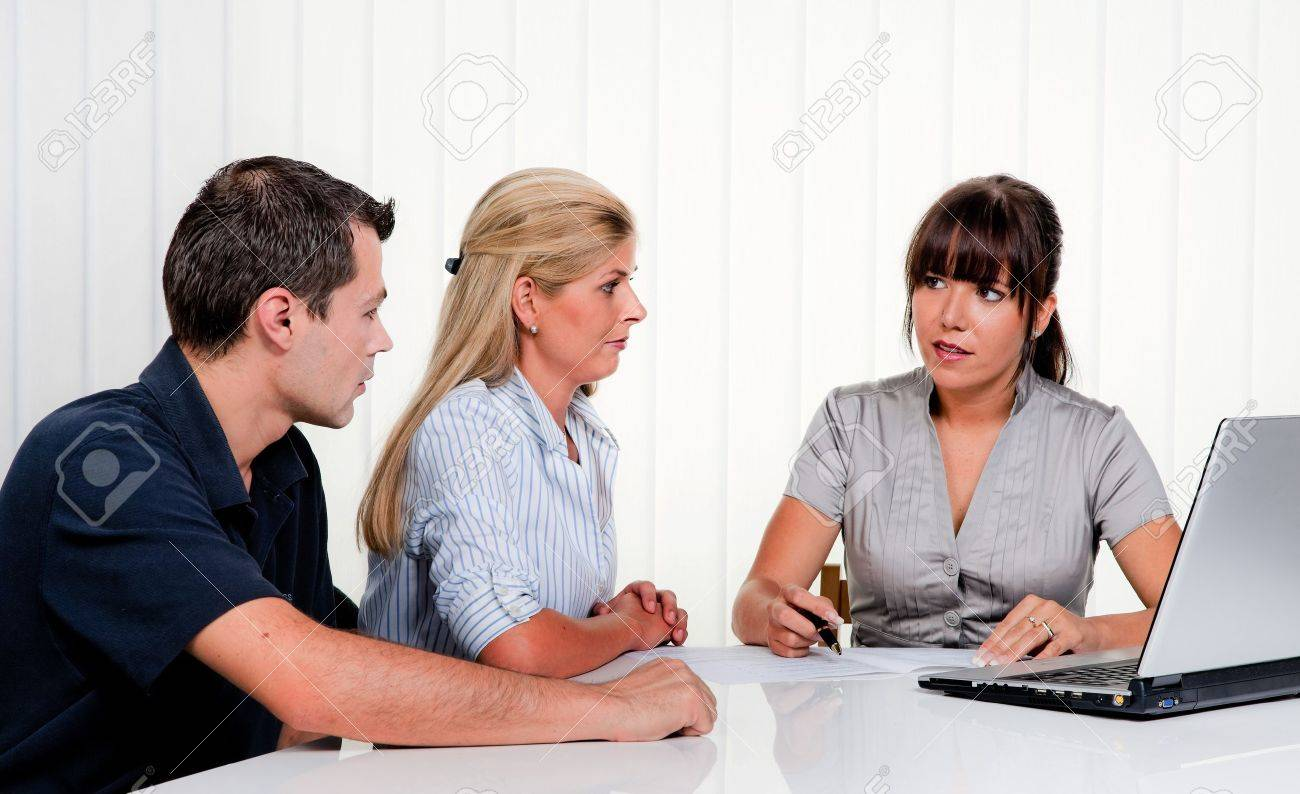 Husband and wife in a consultation in an office Stock Photo - 9637728