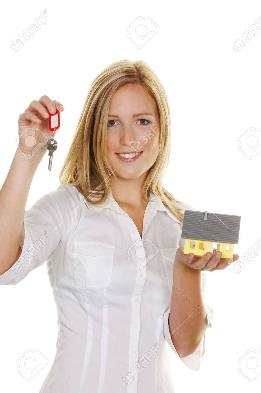 A young woman with a model house and apartment keys. Stock Photo - 10486700