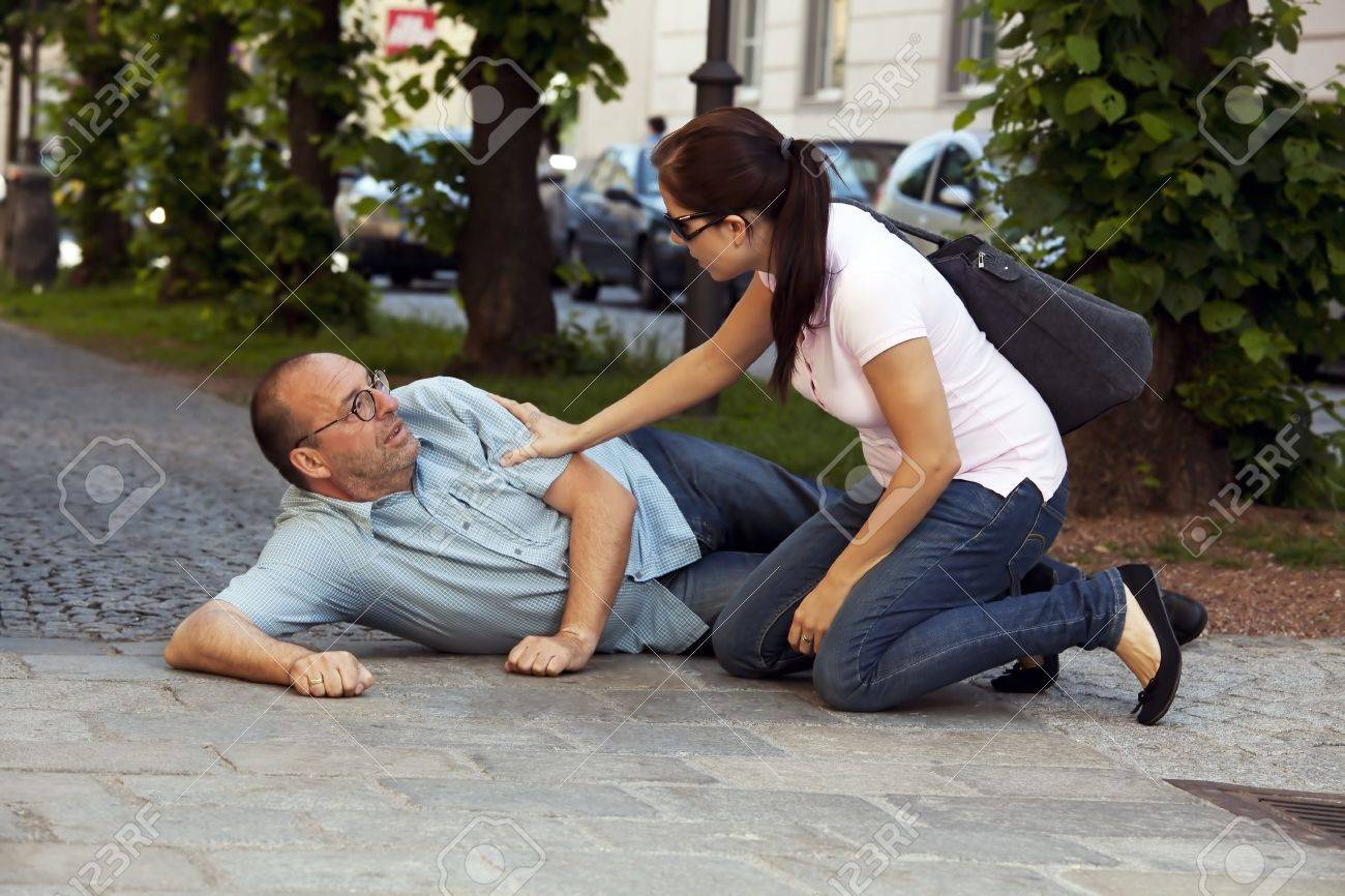 A man has a heart attack or stroke on the road Stock Photo - 10514249