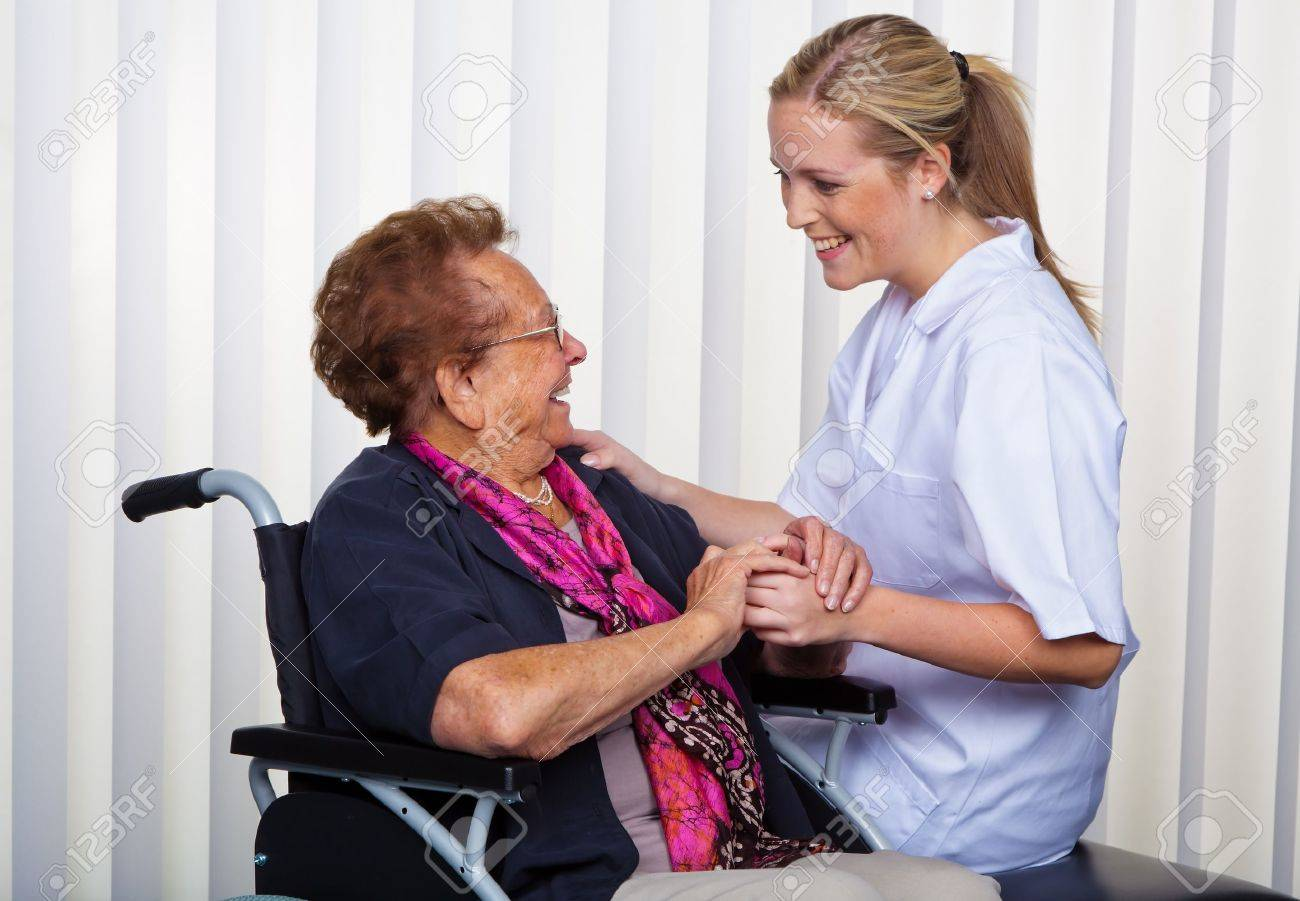 a nurse and an old woman in a wheelchair. Stock Photo - 10860678