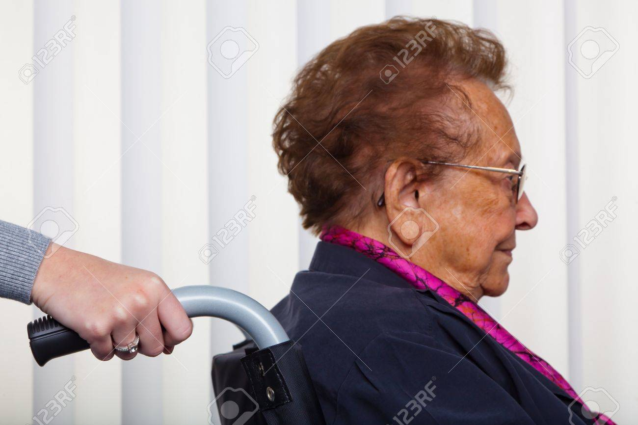 a nurse and an old woman in a wheelchair. Stock Photo - 10860670