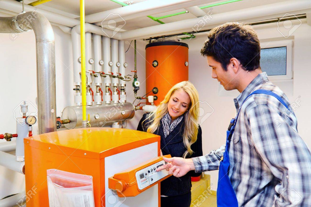 young engineers in heating boiler heating system with Standard-Bild - 11104150