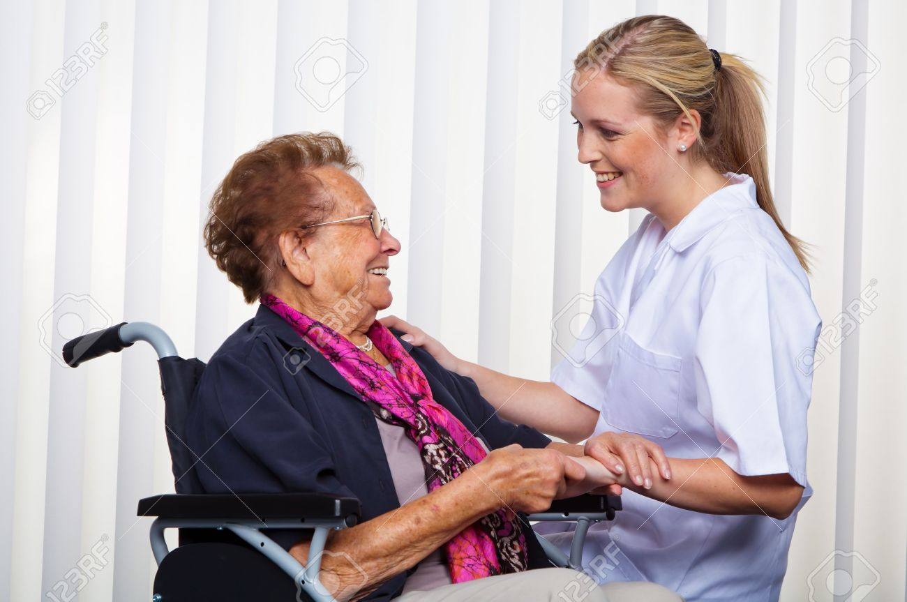 a nurse and an old woman in a wheelchair. Stock Photo - 11153884
