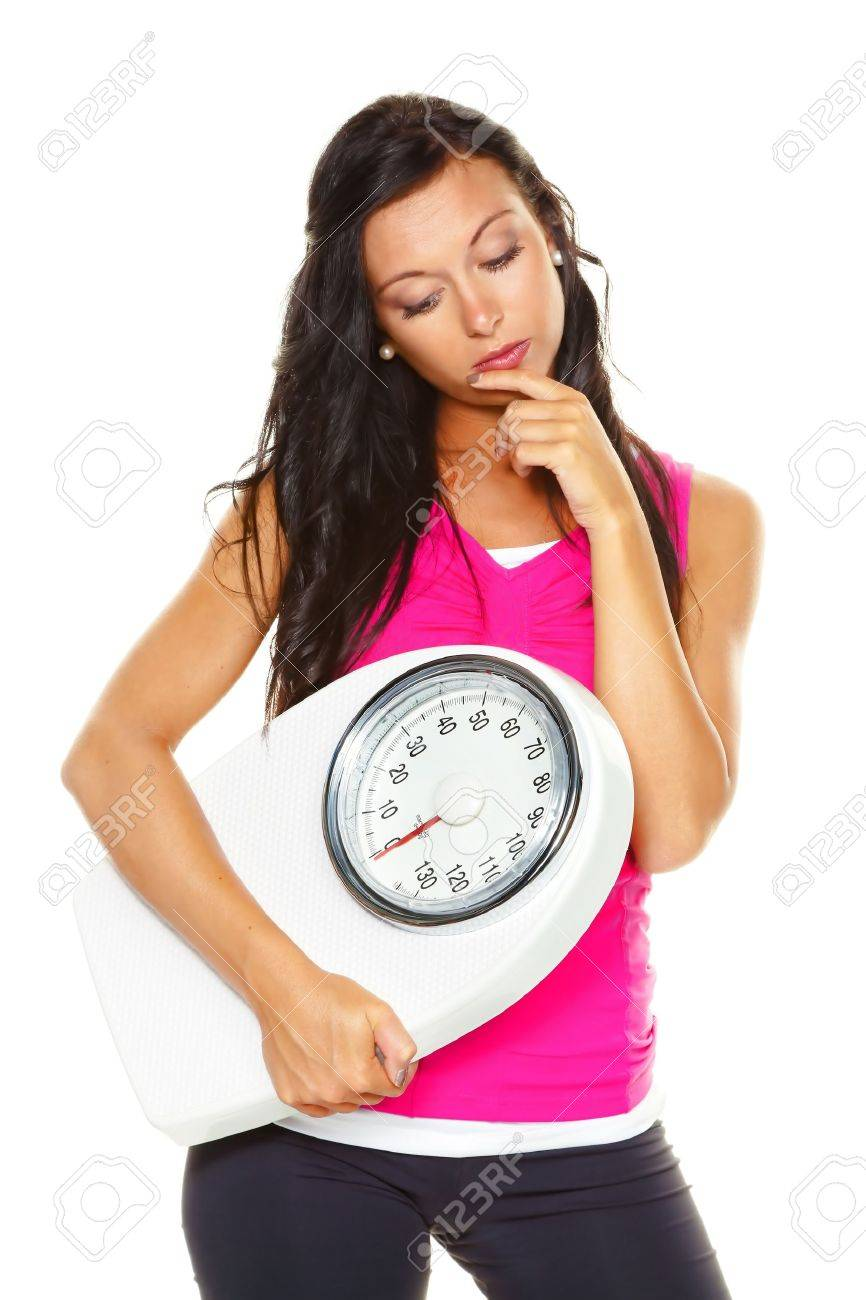 a young woman is unhappy with your body weight. try to be easier on the scale. Stock Photo - 11153877