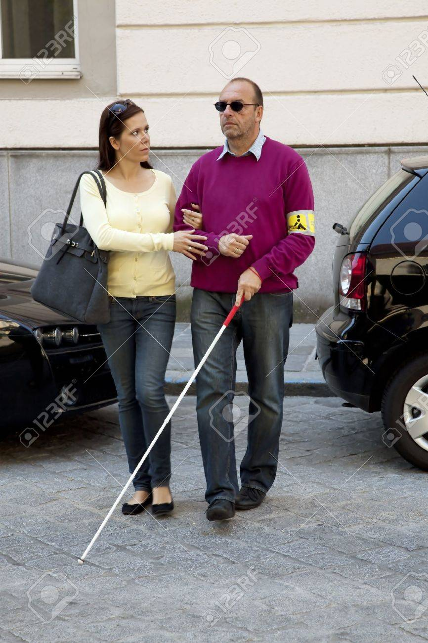 a young woman helps a blind man on the street Stock Photo - 11153960