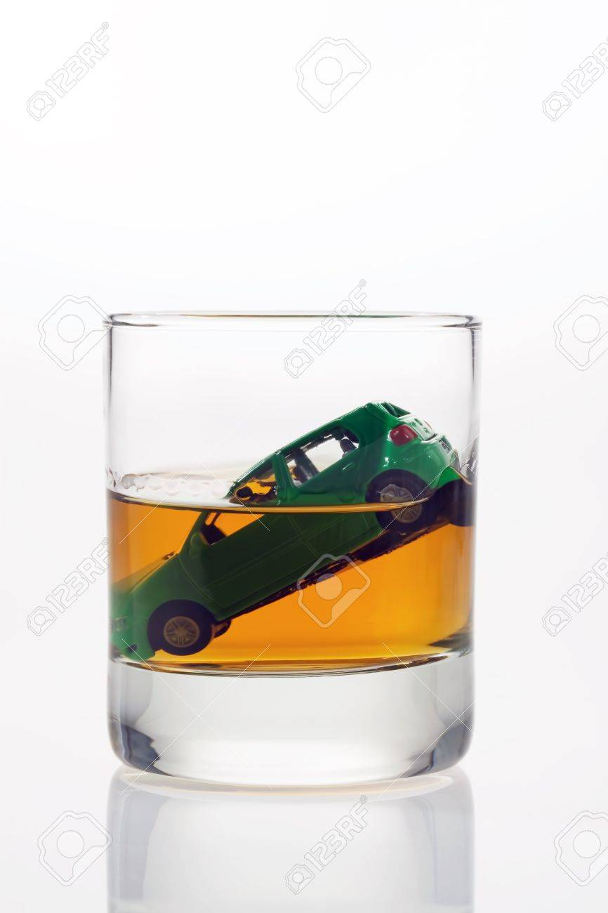 car keys and a jar of alcohol on a table Stock Photo - 11153935