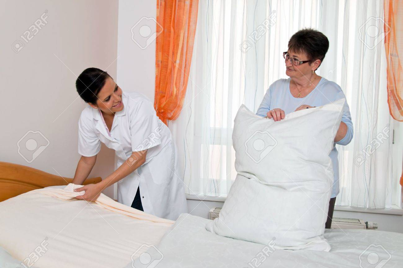 a nurse in elderly care for the elderly in nursing homes Stock Photo - 11276396