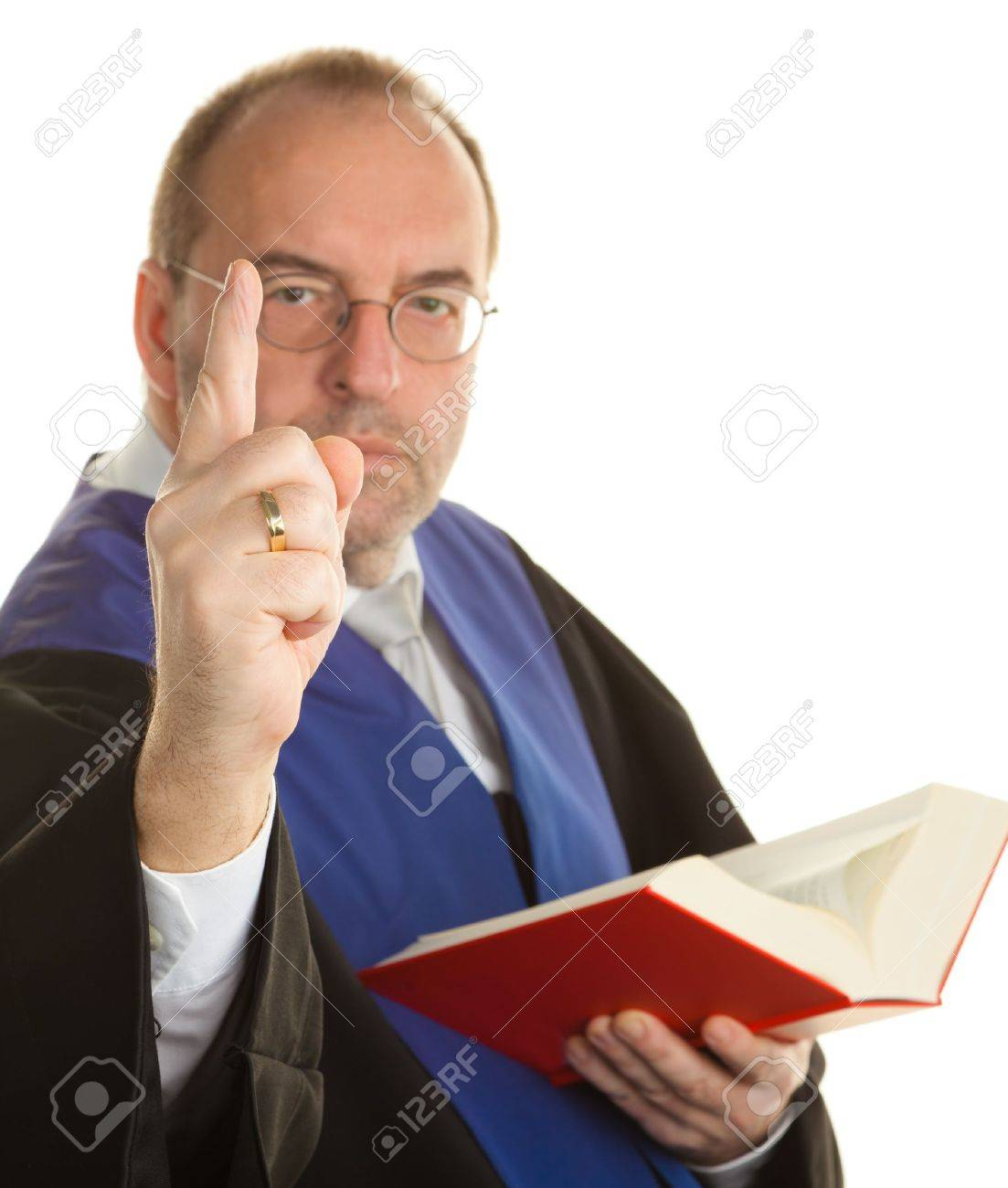 a judge with a law book in court. against a white background Stock Photo - 11276389