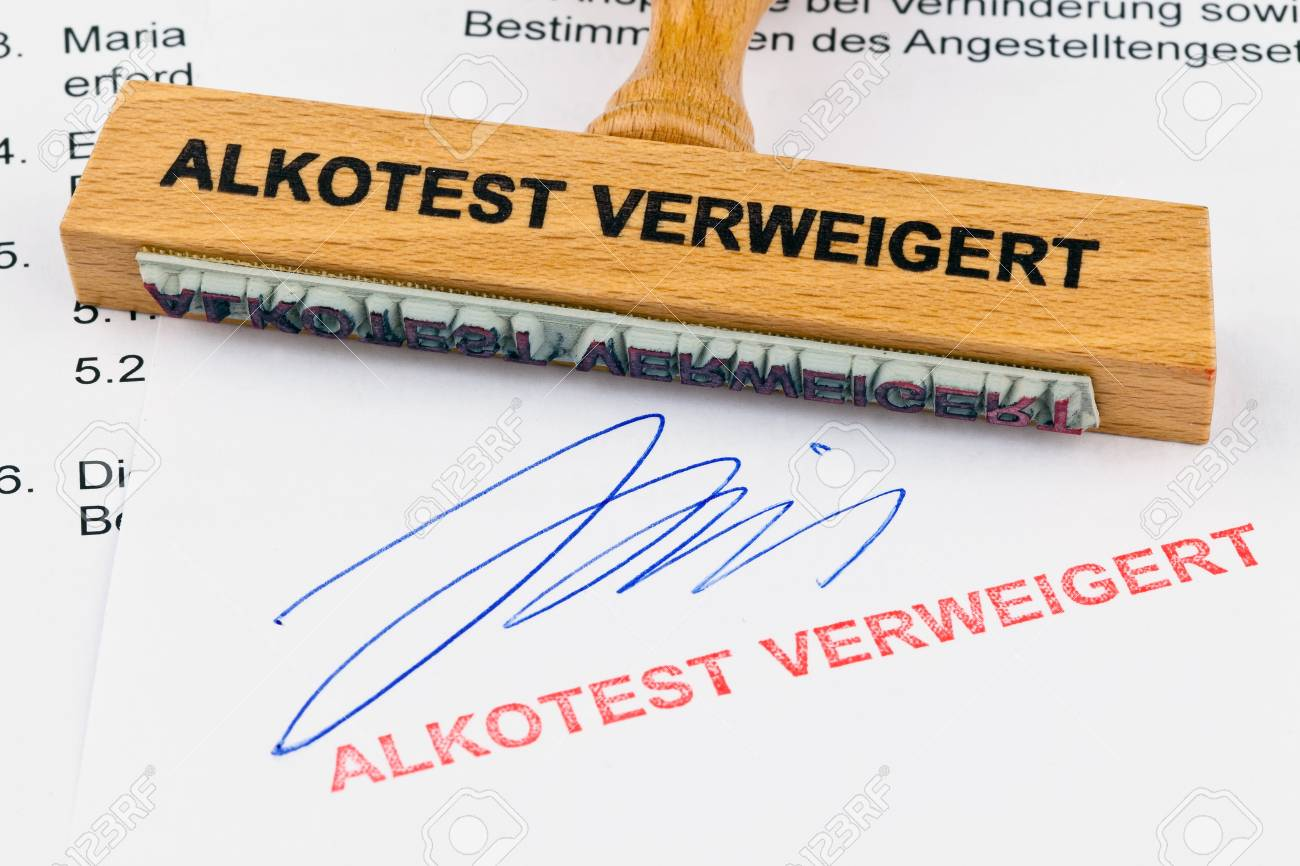 a stamp made of wood lying on a document. inscription alkotest denied Stock Photo - 11622589