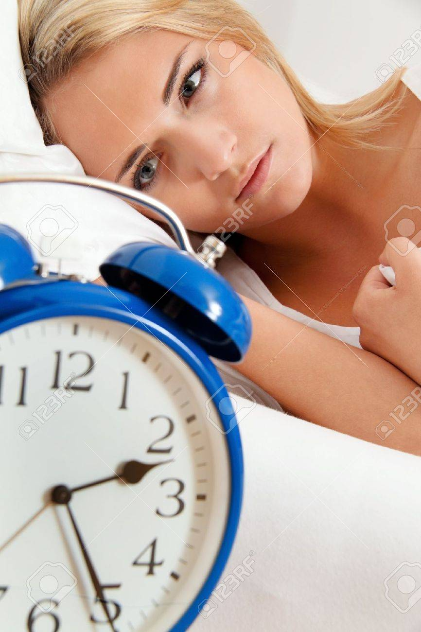 clock with sleep at night. woman can not sleep. Stock Photo - 12080654