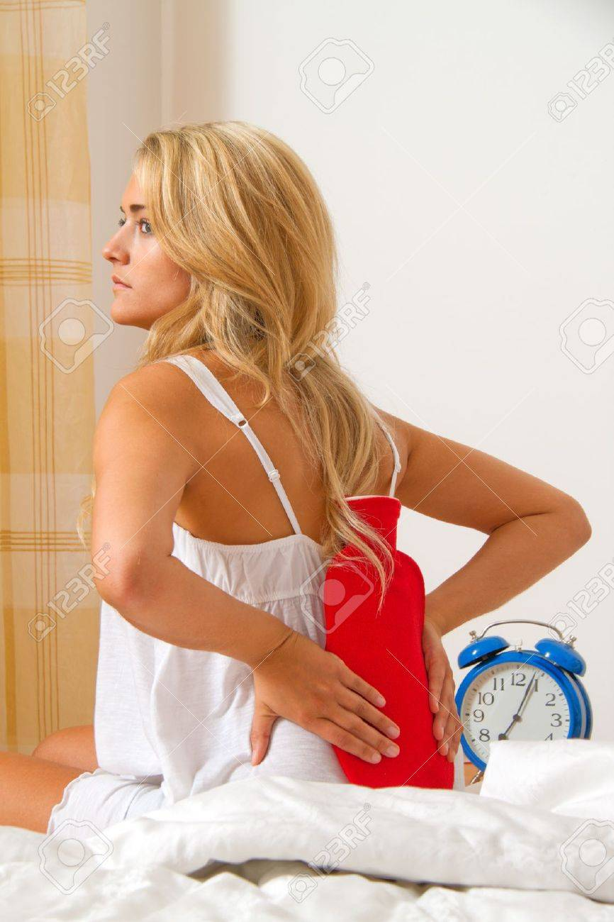 sick with pain in the back. intervertebral disc and spine. Stock Photo - 12080707