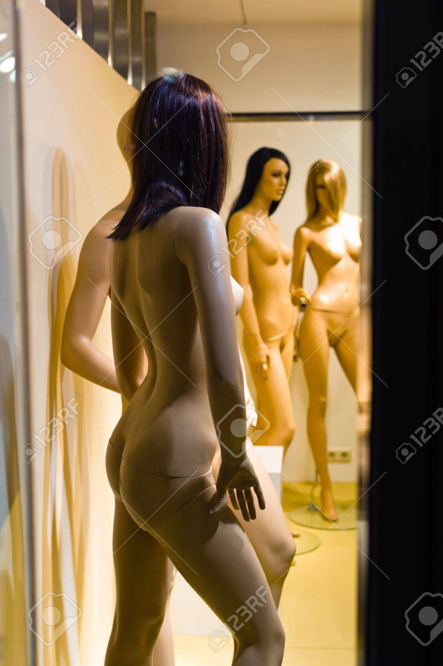 a naked doll stands in a window of a shop for clothing Stock Photo - 12148290