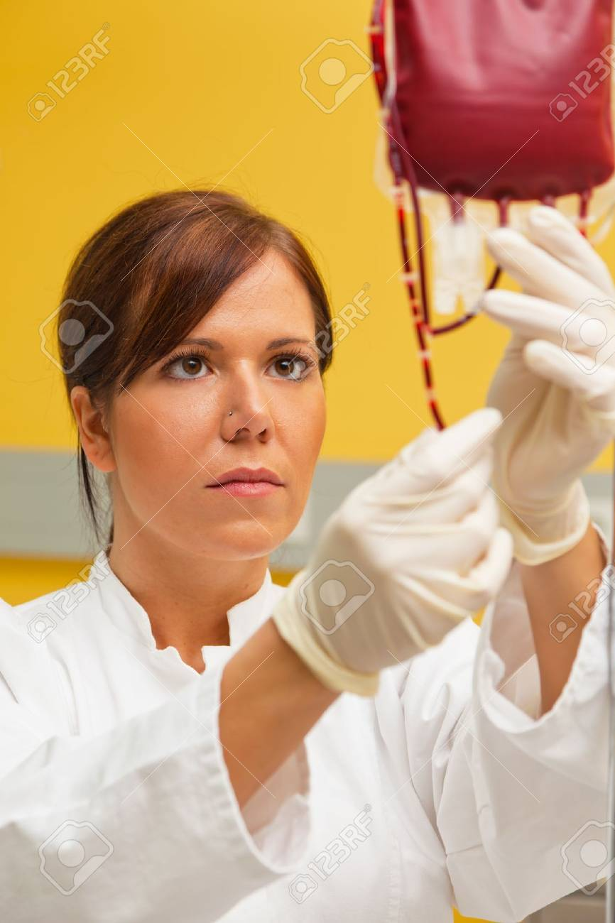 a nurse in the hospital with blood products  infusion of donor blood Stock Photo - 13599110