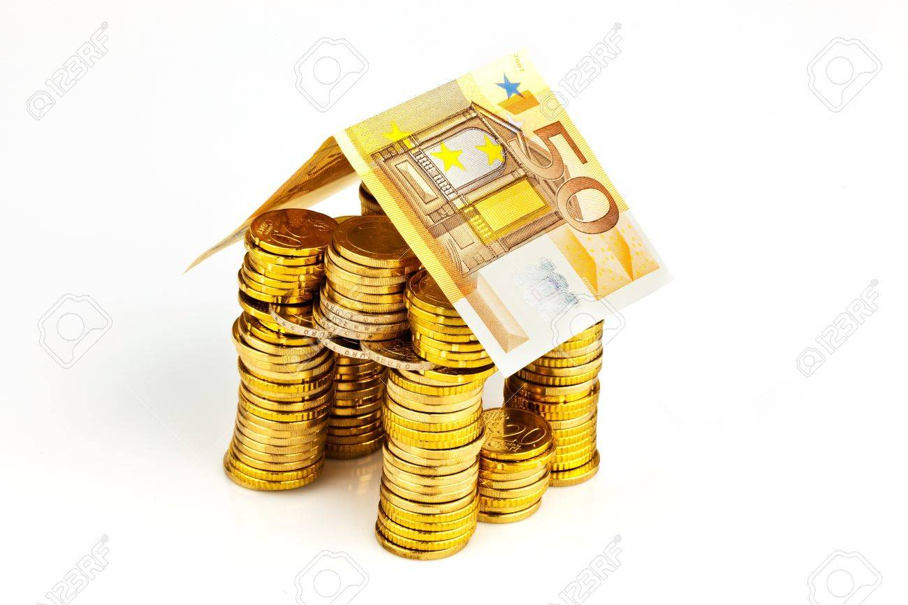 a house made of coins and banknotes  photo icon for house construction and home loans Stock Photo - 13776724